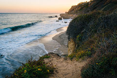 View of the Pacific Ocean and cliffs at sunset, at El Matador St. Ate Beach, Malibu, California Royalty Free Stock Photography
