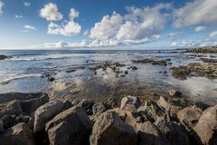 View of the pacific ocean from the rocky coast of Hanga Roa royalty free stock photo
