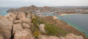 View of Pacific and Sea of Cortes and Cabo San Lucas marina as seen from the top of Mount Solmar in Baja California Mexico. View of Pacific Ocean and Sea of Royalty Free Stock Photos