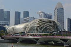 View across the Padang to Esplanade Theatres on the bay, Singapore. View from the Padang across to Esplanade Theatres on the bay. The building contains a concert Stock Photos