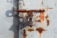 View of the padlock on the rusted gate Stock Image