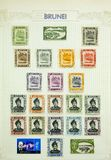 Wonderful Postage Stamps. View of a page of postage stamps from Brunei on a sheet of paper royalty free stock photo