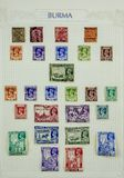 Wonderful Postage Stamps. View of a page of postage stamps from Burma on a sheet of paper royalty free stock image