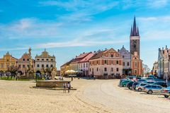 View at the Painted houses and Holy Ghost church from Main place in Telc - Czech republic, Moravia Royalty Free Stock Images