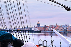 View of the Palace Embankment and St. Isaac`s Cathedral from board of the barque Sedov. Royalty Free Stock Photo