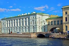 View of Palace embankment and the Winter canal to the Neva river. ST.PETERSBURG, RUSSIA - AUGUST 09, 2017: View of Palace embankment and the Winter canal to the stock photography