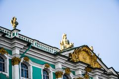 Gold-plated sculptures on the roof of the Hermitage, city St. Petersburg. View from the Palace Square to the walls of the Hermitage & x28;Winter Palace& x29;, St stock photography