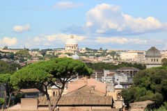 View from the Palatine Hill at Rome and the Papal Basilica. The Italian capital of Rome and the Saint Peter's Basilica seen from the Palatine Hill. The Basilica stock photos