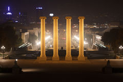 View from Palau Nacional towards the Four Columns and Placa d Espanya at night in Barcelona Stock Photography