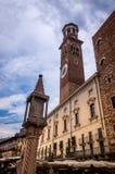 View at the Palazzo della Ragione and Arco della Costa in Verona, Italy stock images
