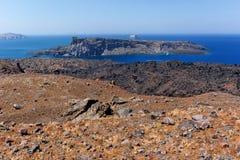 View of Palea Kameni island from volcano in Nea Kameni near Santorini, Greece Royalty Free Stock Photos