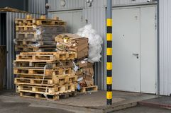 View on pallets, boxes in front of the door of the warehouse or store Royalty Free Stock Photos