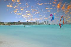 View on Palm Beach at Aruba island in the Caribbean Sea at sunse. T Royalty Free Stock Images