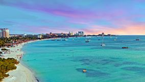 View on Palm Beach at Aruba island at sunset Stock Images
