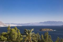 View of the palm trees in the foreground and small islands in th Royalty Free Stock Images
