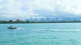 View of Panama City skyline with skycrappers and boat crossing in the water. View of Panama City skyline with big skycrappers and boat crossing in the water stock footage
