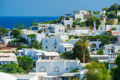 A view of Panarea island with typical white houses, Italy. stock image