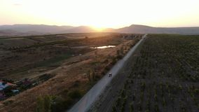 View of the panorama from the mountain ranges and vineyards of the mongering. The last rays of the sun shine in leaves stock video footage