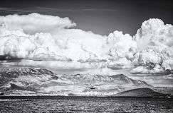 View from the Pantan Beach in Trogir. To the hills and Split city. Travel destination. Black and white photo stock image