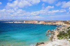 View of Paradise Bay, Malta. Rocky coastline with hotels to the rear, Paradise Bay, Malta, Europe Royalty Free Stock Photo