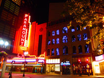 View of the Paramount theater at night with neon sign illuminat Stock Photography