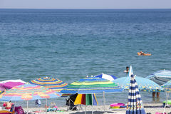 View of the parasols at the beach of Katerini in Greece. Stock Photo