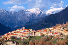 View of Pariana, ancient rural town in the foothills of the Apuan Alps still snowy. Stock Photos