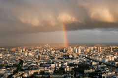 View of Paris from above. Rain, clouds, rainbow. stock images
