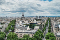 View of Paris from the Arc de Triumph. View of the Eiffel Tower from the Arc de Triumph in cloudy day Stock Image