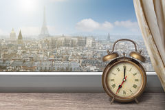 View of Paris and Eiffel tower from window with alarm clock Stock Photography