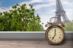 View of Paris and Eiffel tower from window with alarm clock Royalty Free Stock Photography