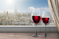 View of Paris and Eiffel tower from window with two wine glasses Royalty Free Stock Photos
