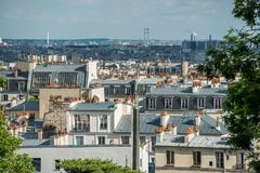 A view of Paris, France taken from a high vantage point shows an urban area bordering an industrial area. The densely populated housing units look out over the Stock Photography