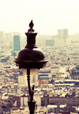 View of Paris from Montmartre. Dove, sitting on a pole in the background of Paris Royalty Free Stock Images