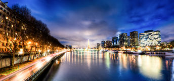 View of Paris by night - France. View of Paris along docks by night - France Royalty Free Stock Images
