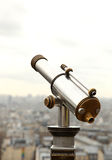 View of Paris and a telescope Royalty Free Stock Images