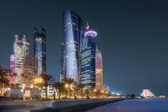 View of park and building in Doha City Center. At night, Qatar. Clipping path of sky stock images