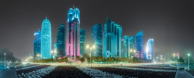 View of park and building in Doha City Center. At night, Qatar. Clipping path of sky stock photo