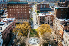View of a park and Monument Street, in Mount Vernon, Baltimore, Royalty Free Stock Photo