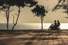 View of park near sea which has some family drive motorcycle on road. In morning royalty free stock images