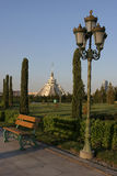 View from the Park to the Commercial Centre. Lamppost, banch, trees and Commercial Centre as a Egypt pyramid. Ashkhabad. Turkmenistan Stock Images