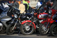 View of parked motorcycles from the sunny side stock photo