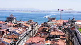 A view part of the city Lisbon and Tejo river. Stock Photos