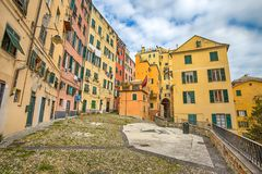 View of a part of old city called `Campo Pisano`, a square with colorful houses in Genoa, Italy stock image