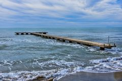View particular concrete pier. In the sea royalty free stock photos