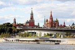 View of the Paryashchiy most the River Overlook Deck or Soaring Bridge in Zaryadye Park, Moscow Kremlin and St. Basil`s Cathedra royalty free stock image