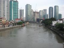 View of the Pasig river from a bridge, Makati city, Philippines royalty free stock image