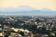 View of Pasig River and Metro Manila, with mountains. The Pasig River is highly polluted now, but was once a beautiful and bustling attraction for metro Manila stock photography