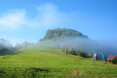 View of Pass Nimchich in sunny autumn morning, blue sky and fog. Over mountain Royalty Free Stock Photo