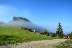 View of Pass Nimchich in sunny autumn morning, blue sky and fog. Over mountain Stock Photo